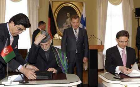 Karzai, Katainen sign cooperation accord